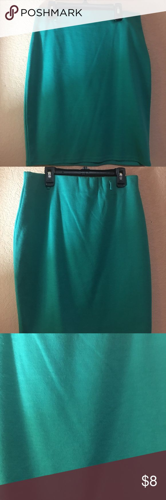 Turquoise skirt Turquoise mini skirt , in great condition no stains or tears but it is missing its belt . Brat Star Skirts Mini