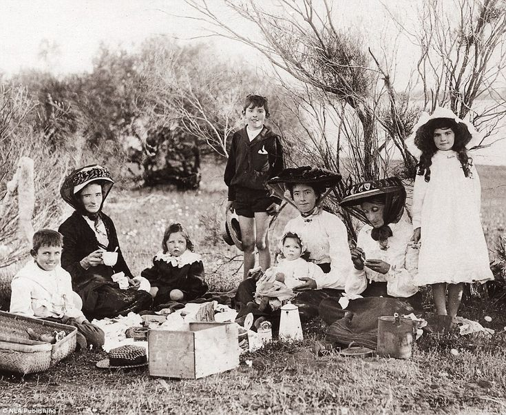 This group is enjoying a picnic at an unknown location in an undated photograph. Picnics a...