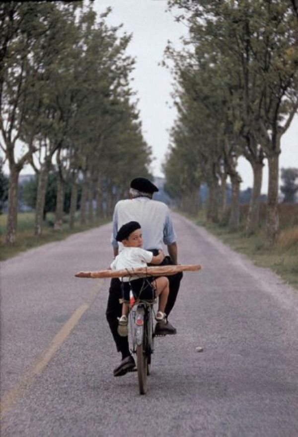 'Granddaddy on bicycle with litlle boy and baguette, Provence' by Elliott Erwitt,