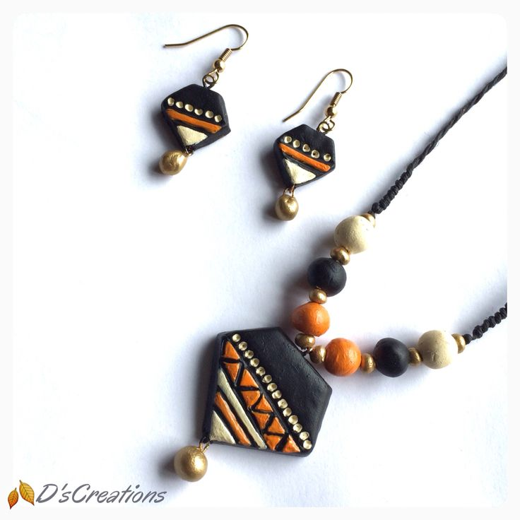 Black, orange and cream color combination neckwear and earring set