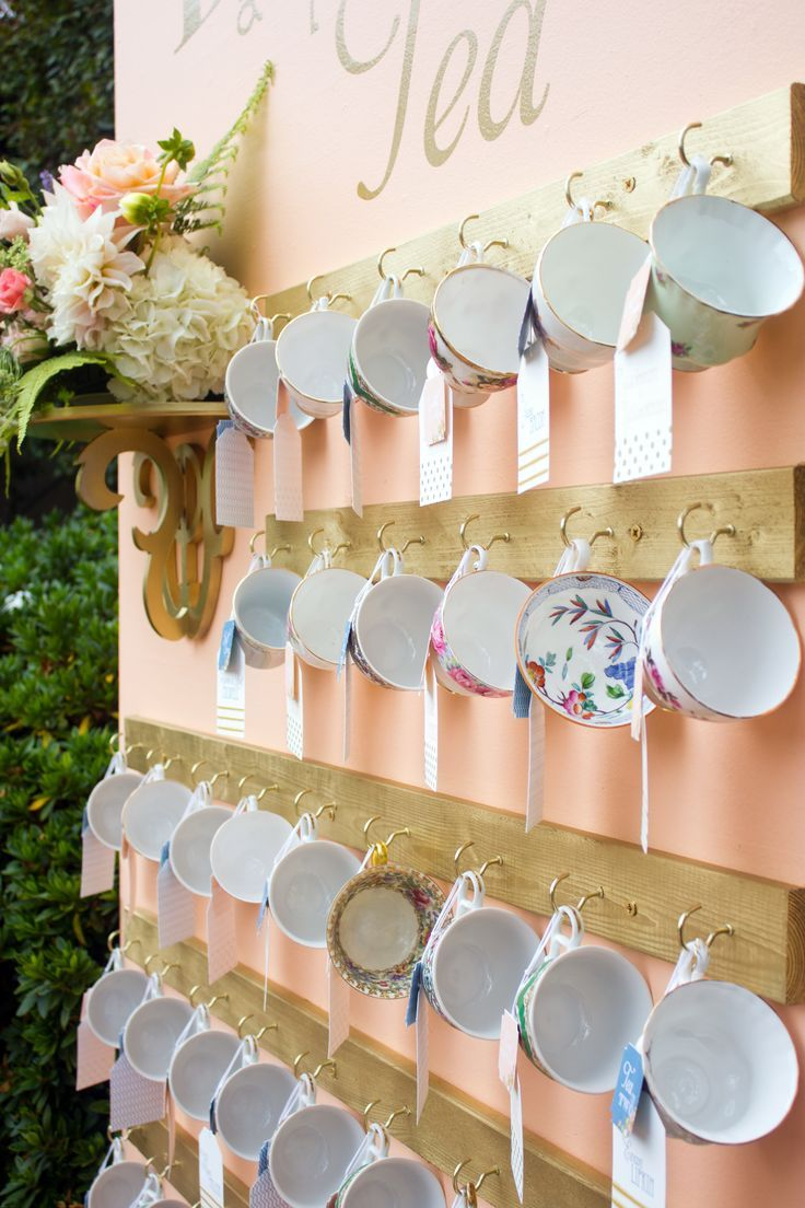 Everyone gets a different mug or a mug with their name on it.  Tea Inspired Wedding Escort Cards