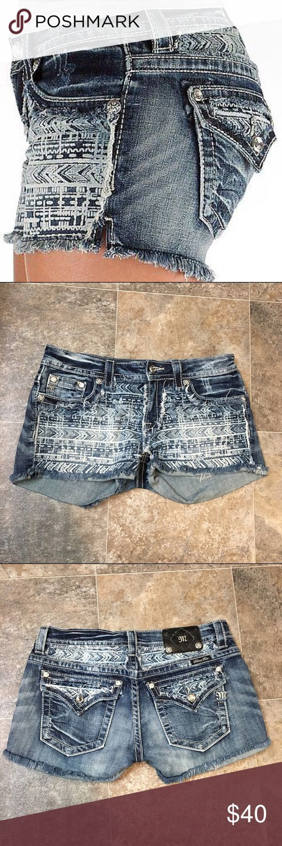 Miss me Aztec jean shorts Prep for the summer with these fun Aztec Miss Me jean shorts. They have Aztec detailing on the front and back and they have a gem button in the front. They're a size 30. They're in great condition, the only flaw is that the Miss Me plate in the back is missing 2 buttons.   BUNDLE AND SAVE  NO TRADES REASONABLE OFFERS CONSIDERED  FEEL FREE TO ASK QUESTIONS I DO NOT MODEL Miss Me Shorts Jean Shorts