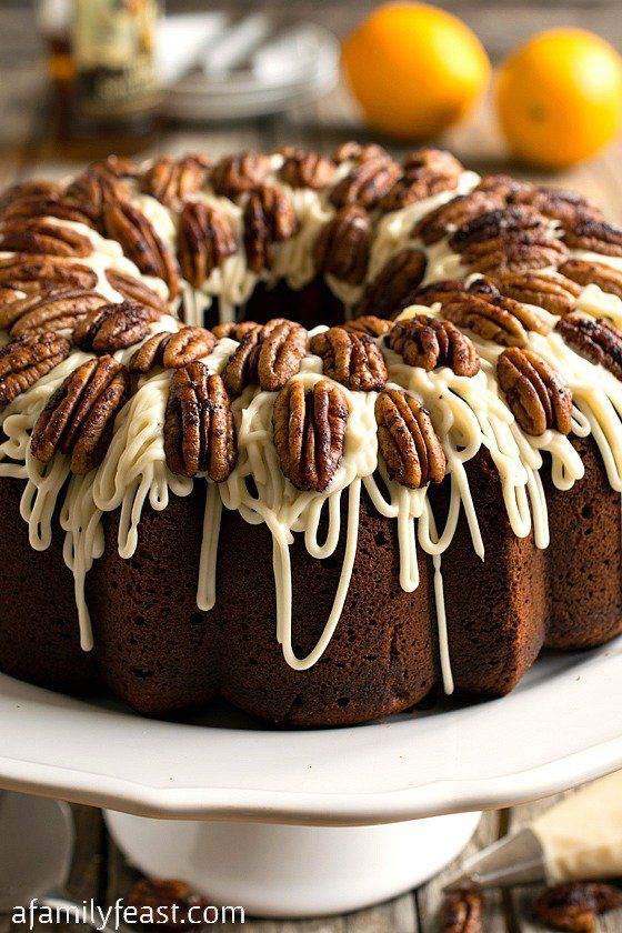 Spiced Rum Bundt Cake - A moist and delicious cake with a spicy rum flavor and a sweet cream cheese icing, topped with spiced toasted pecans.  A very special cake!