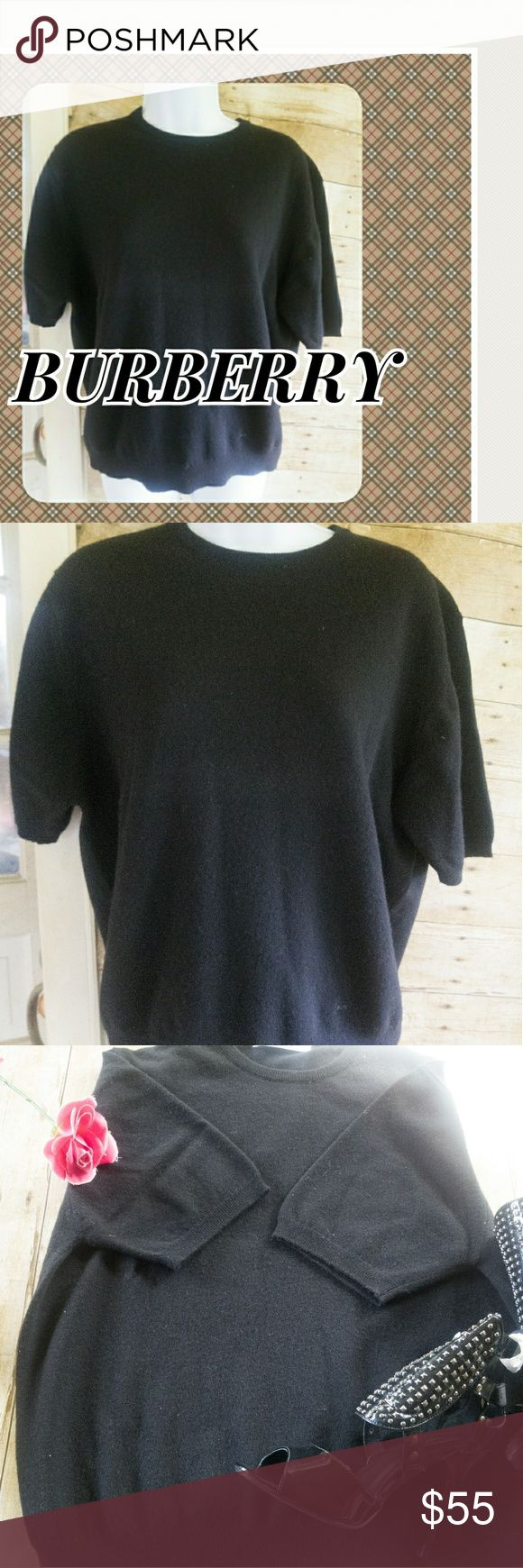 BURBERRY LAMBSWOOL VINYAGE  SWEATER VINTAGE BURBERRY LAMBSWOOL LIGHTWEIGHT SWEATER.  I HAVE HAD THIS VINTAGE PIECE FOR AWHILE AND IT HAS ONLY BEEN WORN TWICE. IT FEELS LIKE CASHMERE. THE COLOR IS ALL BLACK AND THE SIZING ON THE TAG SAYS 46, 117 CM. THIS CAN FIT A MEDIUM TO A LARGE..REALLY NICE PEICE.  I AM TAKING REASONABLE OFFERS ON THIS. WILL BE DRY CLEANED BEFORE SHIPPING OUT AS IT HAS BEEN SITTING..pre loved no snags stains or holes Burberry Skirts