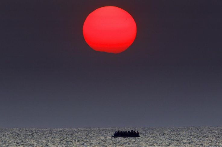 """AUG. 11, 2015 A dinghy loaded with Syrian refugees drifts in the Aegean Sea between Turkey and Greece United Nations High Commissioner for Refugees (UNHCR) called on Greece to take control of the """"total chaos"""" on the Mediterranean islands, where thousands of migrants have landed. About 124,000 have arrived this year by sea, many via Turkey, according to Vincent Cochetel, UNHCR director for Europe. (REUTERS/Yannis Behrakis)"""