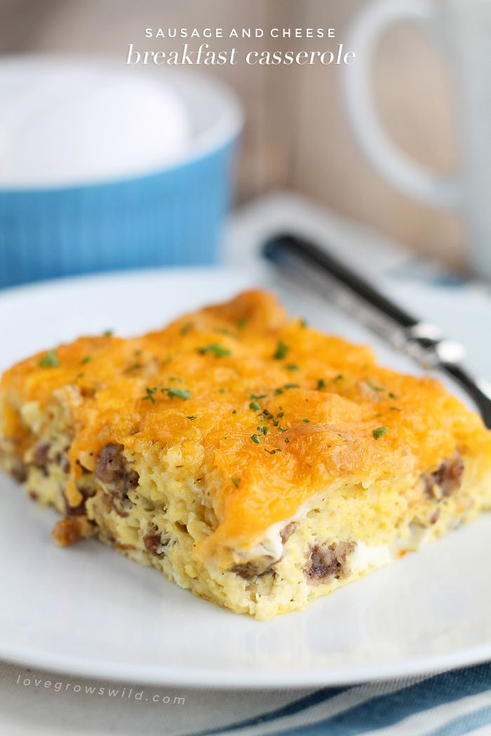 This easy overnight egg casserole is loaded with breakfast sausage and topped with tons of cheddar cheese. Chill overnight then bake in the morning for a delicious, hearty breakfast! | LoveGrowsWild.com @lovegrowswildlf
