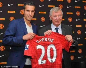 Robin Van Persie Manchester United number 20 with Manager Sir Alex Ferguson. Welcome to Manchester from Arsenal