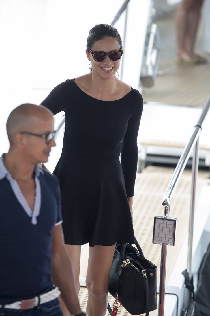 Pin for Later: These Latinas Impressed at Cannes With Their Gorgeous Style Adriana Lima For a yacht ride, Adriana went supercasual with wet hair pulled into a ponytail, no makeup, and a black minidress.