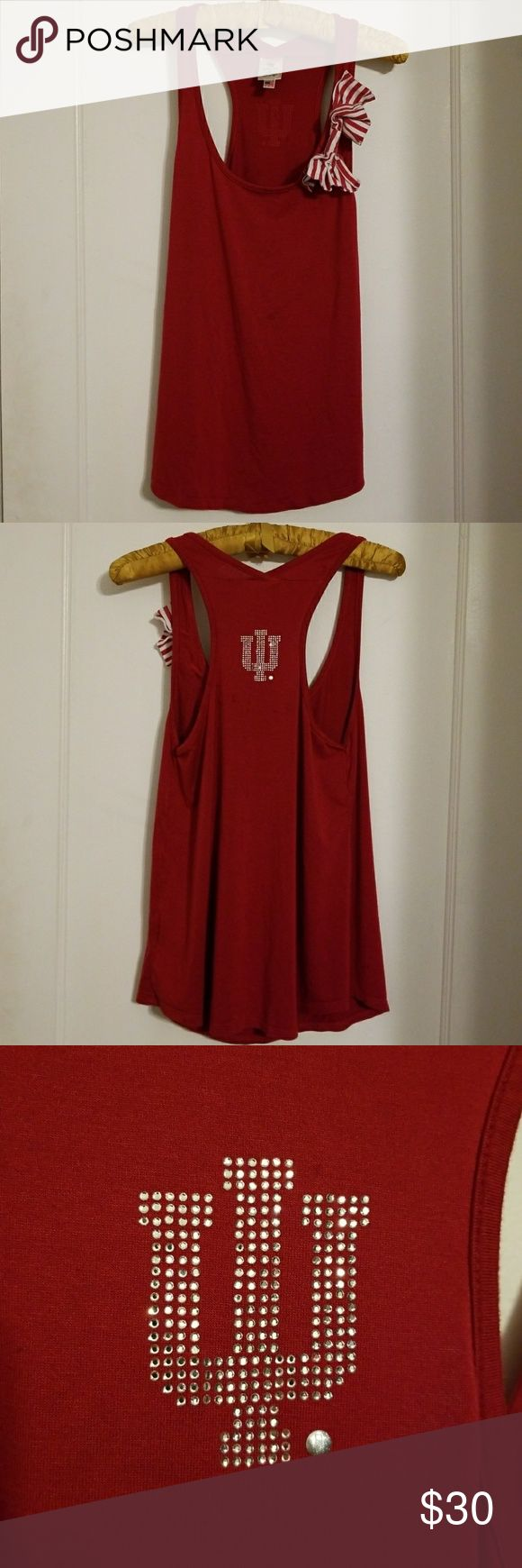Meesh & Mia Indiana University bow tank top Meesh & Mia Indiana University Hoosier racerback bow tank top.   Made in the USA. Size Large but fits like a Medium. Super soft jersey material. Rhinestone IU logo on racerback.  In very good condition. Meesh & Mia Tops Tank Tops