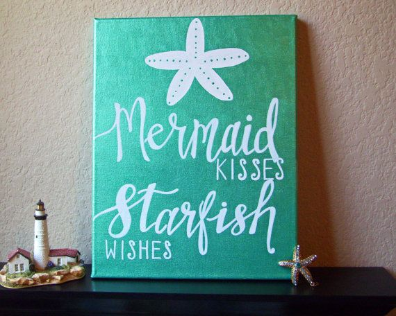 The perfect addition to your coastal-, nautical-, and mermaid-inspired decor, this sign is hand-lettered in white over vibrant, metallic sea
