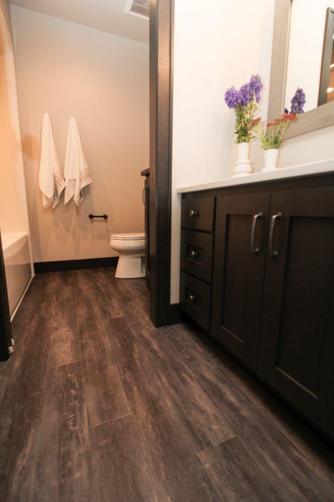 Dark Luxury Vinyl Plank Bathroom Floor In 2020 Vinyl Plank Flooring Bathroom Luxury Vinyl Plank Luxury Vinyl Plank Bathroom