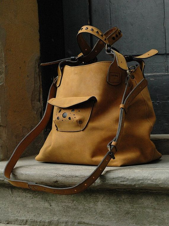 Oversized whiskey color leather bag, with long shoulder strap . Inside big zippered pocket, bag is closed by magnetic clasp. Made from nice leather with
