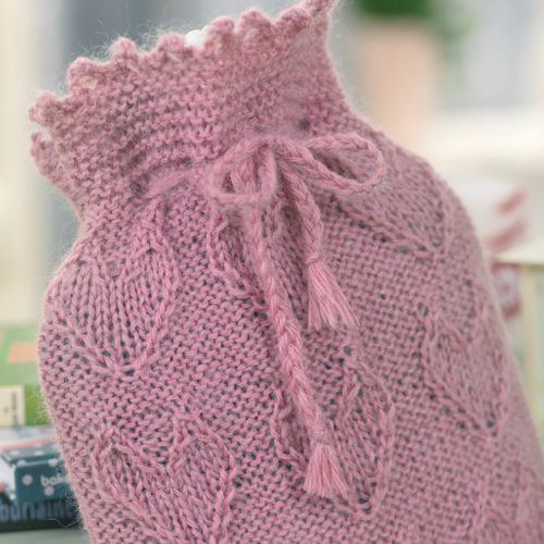 Cosy up with a heart-warming hot water bottle cover by Sian Brown