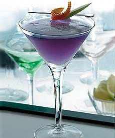 Purple Haze Martini (1 oz. freshly squeezed pomegranate juice   1 1/2 oz. Hypnotiq  1 1/2 oz. pineapple juice  orange rind and apple slice for garnish)