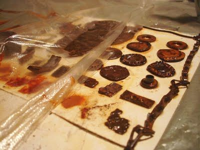 Rust printing - laid out objects on paper, sprayed with vinegar water and covered with plastic