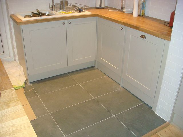 Howdens Burford Grey with wood surface and slate grey floor