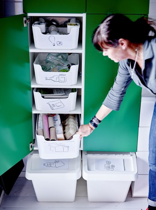 Try a separate bin for each of your recyclables, with bigger ones for higher use items (like maybe plastic or paper) and smaller ones for less common. A picture of what should go inside makes them easy to sort.