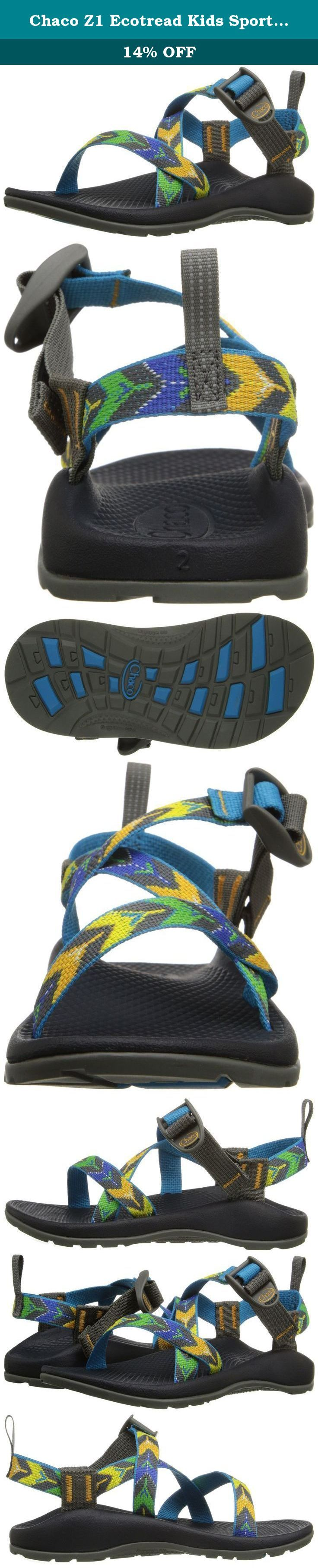 Chaco Z1 Ecotread Kids Sport Sandal (Toddler/Little Kid/Big Kid), Arrows Slate, 5 M US Big Kid. polyester jacquard webbing upper wraps aroudn the foot and through the idsole for a customized fit. Adjustable and durable high tensile webbing heel risers. Injection-molded ladder lock buckle. Durable LUVSEAT PU midsole. Slip restant classic diamond pattern design footbed. Kids Classic outsole. Non-marking EcoTRead 25% recycled rubber content. 2mm lug depth.