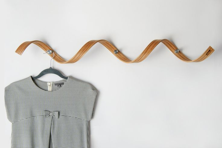 """Unique spiral coat rack / coat hanger made in rare steam bending technique will make a true wow affect at your entryway / hallway.   Materials: Red oak solid wood base Steel hooks Linseed and orange oil finish  Dimensions: 38"""" long x Ø 4.5"""" hook/peg: 1 3/16 long , Ø 7/8"""" between hooks: 13  Each coat rack comes with mounting screws, drywall anchors and install instructions.  Made with care and love in Canada."""