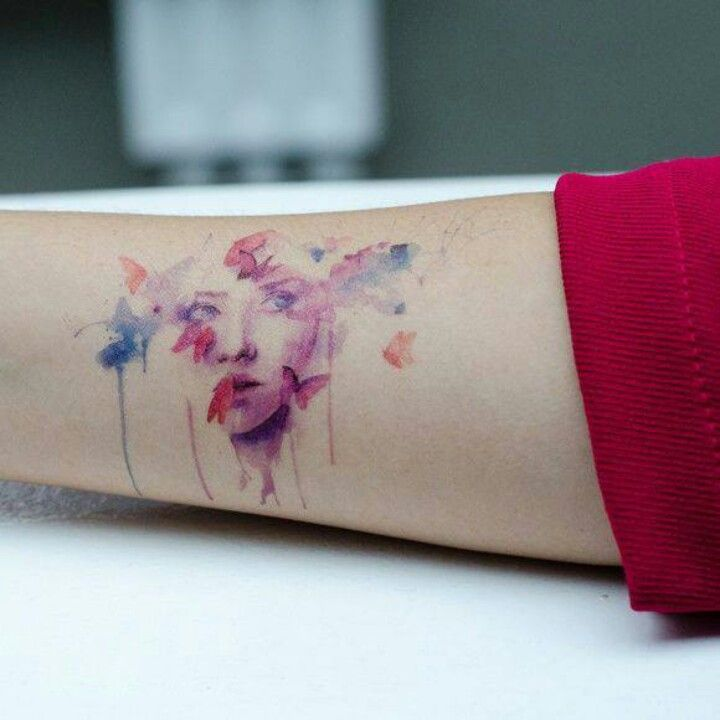 Watercolor tattoo ♡.  I like the butterflies, not the face though