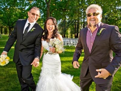Chef Robert Irvine with wife Gail Kim and Guy Fieri.