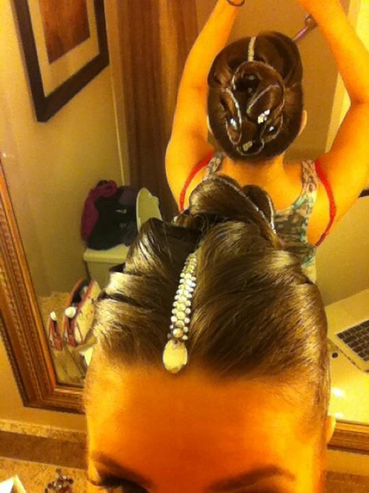 Ballroom hairstyle using multiple swirls to create an elaborate bun with rhinestones. Works well for Standard. Visit http://ballroomguide.com/comp/hair_make_up.html for more hair and makeup info