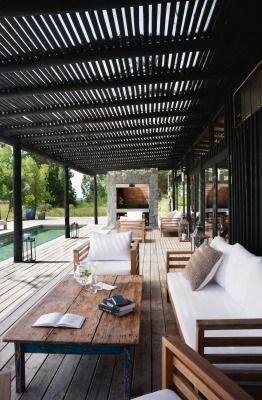 At night, everyone gathers for a poolside meal cooked on the parrilla (grill), seen at the end of the deck. The slatted verandah roof offers welcome dappled shade by day.