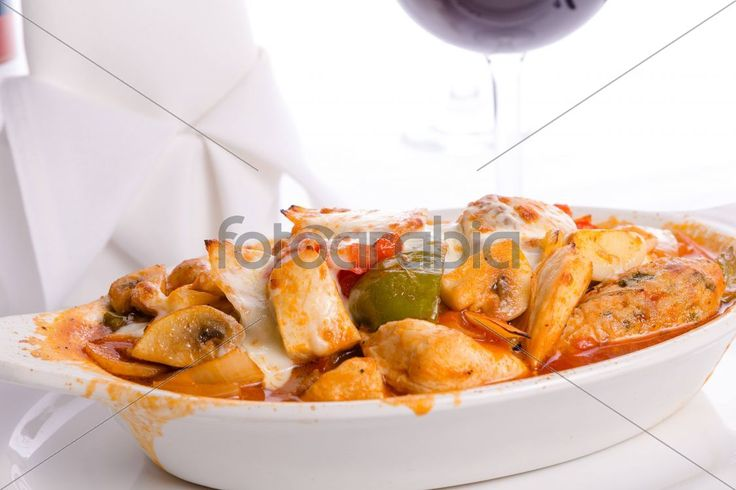 Middle Eastern Style Chicken Saute Baked in Oven in Oval Dish Cheese melted on top of