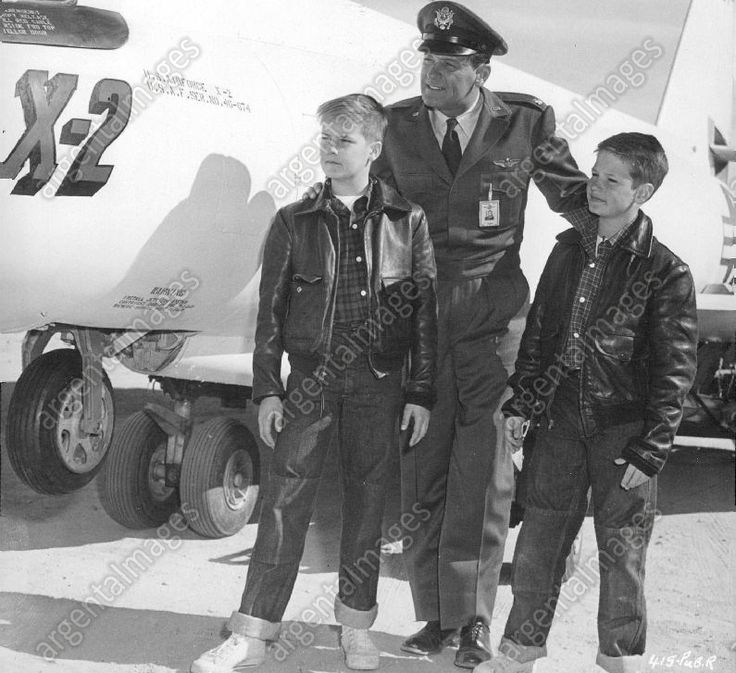 """While working on location near Lancaster, Calif., where sequences are being filmed for """"Toward The Unknown"""" (1956), a Toluca Productions picture for Warner Bros., star William Holden is visited by his two sons, Peter, left, and Scott, right. ."""