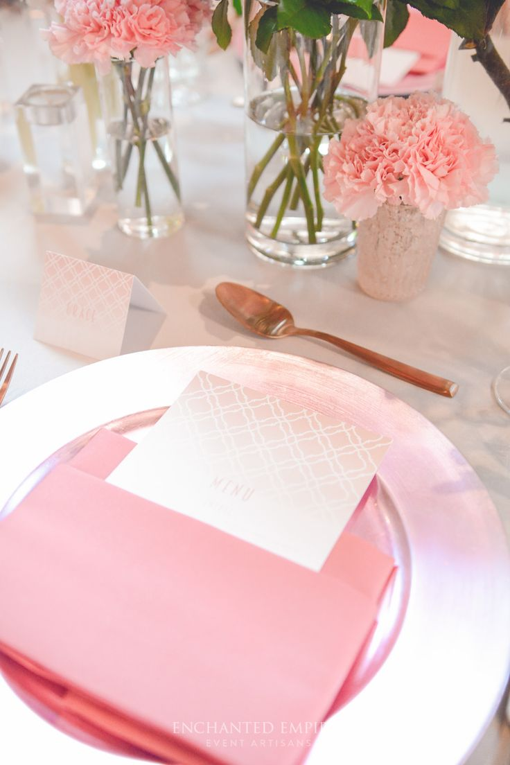 Rose Gold and soft pink blushed hues were complimented by light grey base linen. Dusty Rose Charger plates set the scene for our custom designed stationery, consisting of Menus, Place Cards and Table Numbers, by our in-house Graphics Team. Cascades of pink florals adorned the center of the table with soft pink roses and defined structure of the blossom branches, beautifully put together by our in-house Floral Artisans. See the full film on our You Tube Channel: https://youtu.be/G0aqnDK96D0