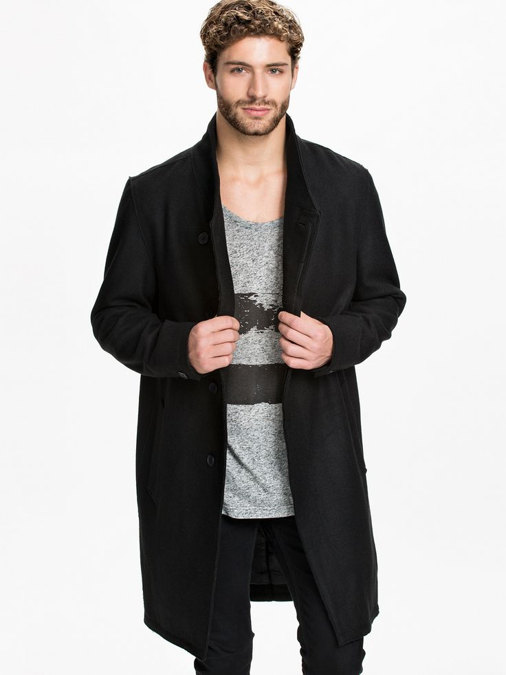 Notion 1.3 Long Coat - Hidden oblique closure and slanted front pockets. Inside pockets on both sides. Raw edged seams. Short placket with a button sleeve cuffs. Fully lined.  Made of 50% Polyester 50% Wool. Lining of 100% Polyester.