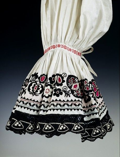 Woman's folk costume    Place of origin:  Hungary (made)    Date:  ca. 1900 (made)    Artist/Maker:  unknown (production)    Materials and Techniques:  Cotton, embroidered with wool
