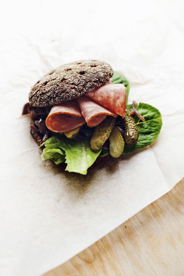 sausage rye bread sandwich with onions & mustard