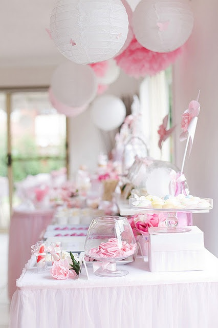 make pink, grey and white or yellow puffy things or Chinese lanterns?