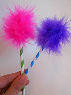 lorax trees. My idea: fuzzy pompoms glued onto pixie stiks as a treat.