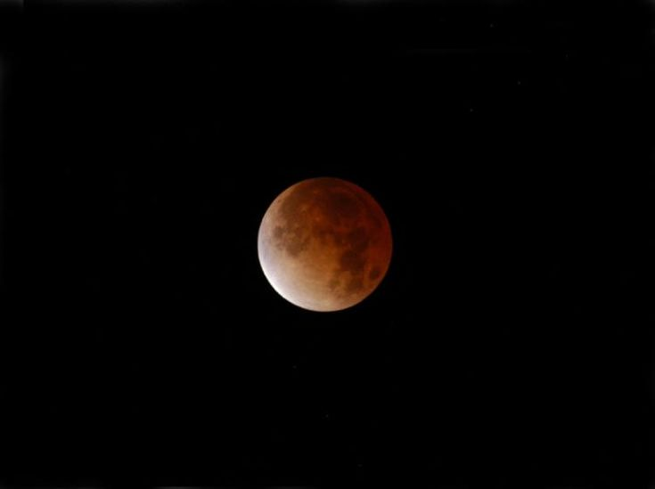 Blood Moon is sometimes used to describe a Total Lunar Eclipse. When the Earth casts its shadow on a Full Moon and eclipses it, the Moon may get a red glow.