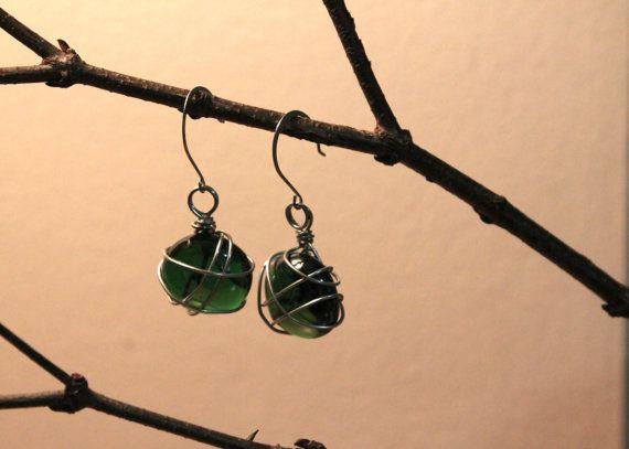 http://www.etsy.com/listing/166016824/emerald-green-entangled-glass-stone