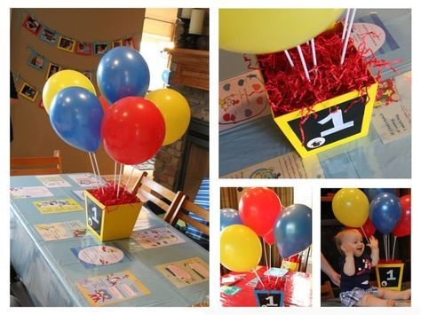 Balloon centerpiece idea for Curious George birthday party