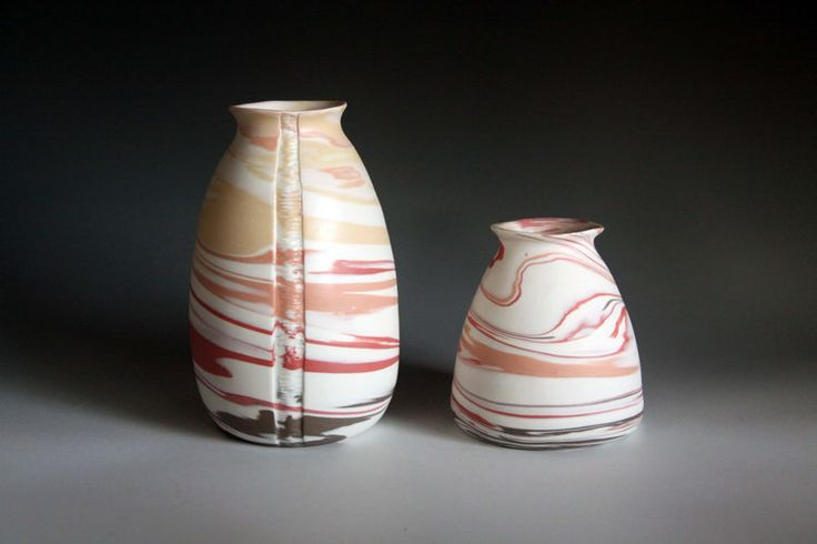 Striation Collection Marbled porcelain clay, wheel thrown, carved and glazed inside. http://www.rediscovering.com.au/portfolio-of-work/#/marbled-porcelain-striation-collection/