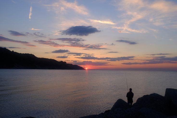 A fisherman at dusk, Pesaro Italy (© Luigi Gallo)