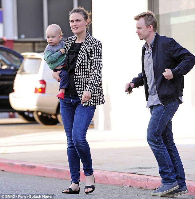 Babys day out: Emily Deschanel cradled son Henry, 20 months, as she sped down the street after a vegan lunch with husband David Hornsby on Thursday