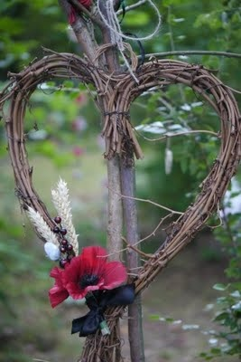 Twig heart, not sure about the poppy though, unless it's in remembrance.