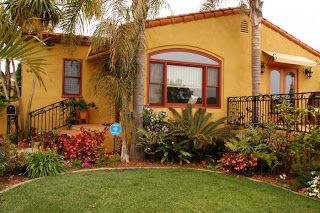 Bright colorful happy little stucco house exterior - Bright house colors for exterior ...