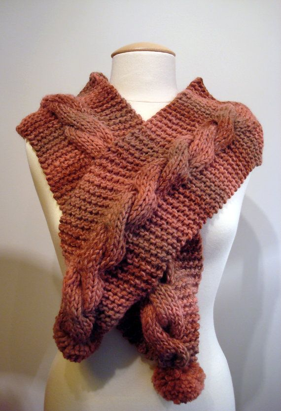 Handmade knitted pink scarf with cables and pom poms