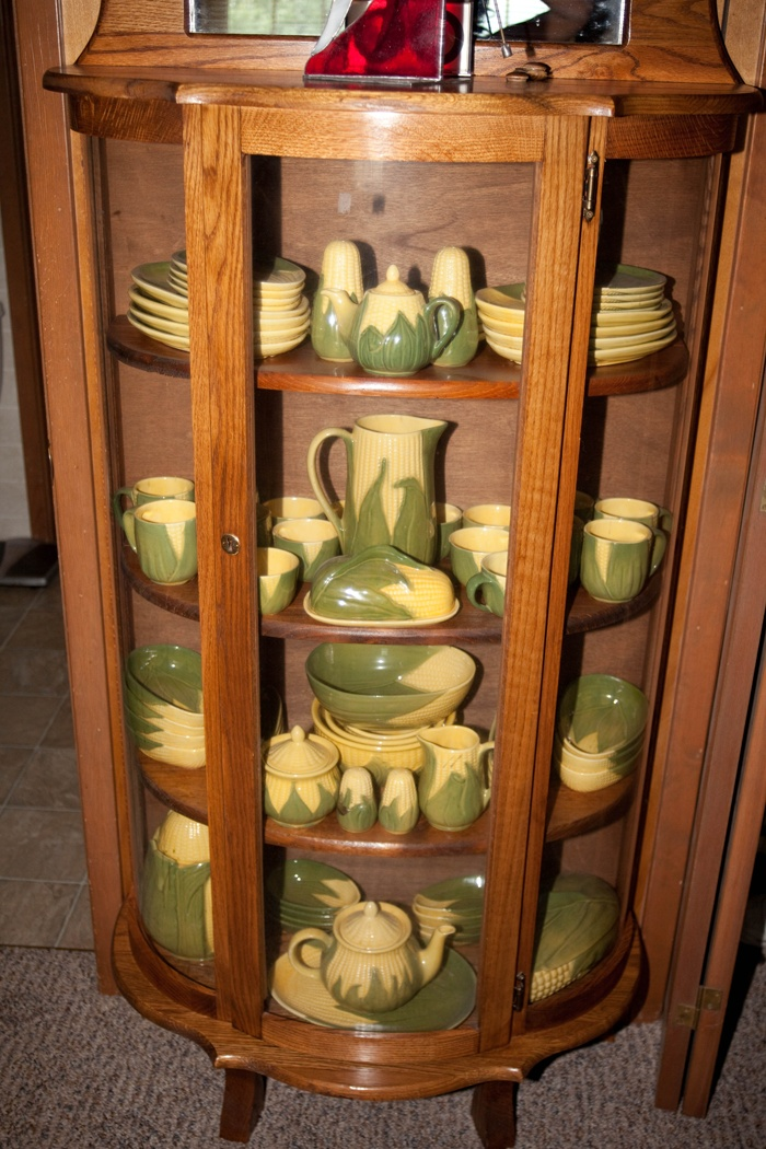 Hutch With Corn King Dishes In It- This looks like my collection!