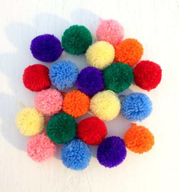 Handmade pom poms made with acrylic wool and trimmed to perfection. Each pom pom is approximately 5cm in size. These loose pom poms can be used for anything you like - added to clothing, used as a decoration or a photo prop.  Just specify your colour/s on ordering and we will contact you to confirm shades. Due to the handmade nature pom poms should be handled with care to avoid losing wool.