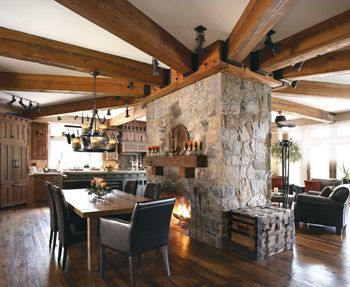 Centered around the massive stone fireplace, the open floor plan is ideal! I love this!