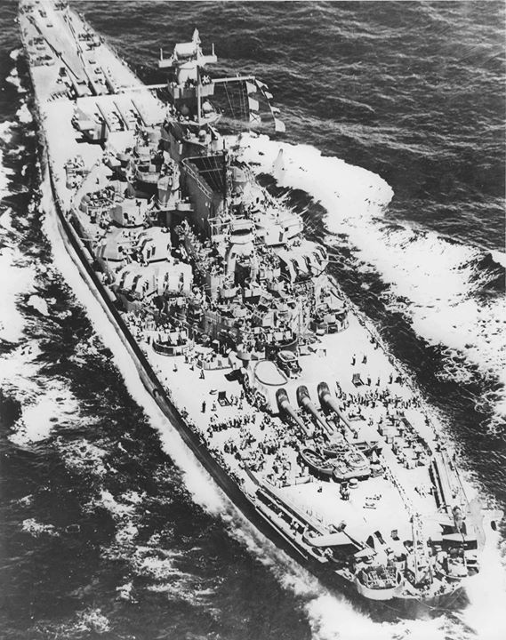 Aerial view of US battleship Massachusetts 1943. Note OS2U Kingfisher float planes on the fantail catapults.
