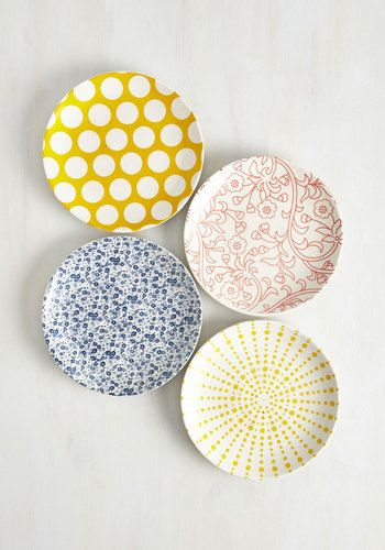 Your cooking style is far from conventional, and this ceramic plate set perfectly complements your daring array of original dishes! When you situate your quirky cuisine atop the navy flowers, coral blooms, goldenrod dots, or mustard sunburst pattern of these glazed plates, you also provide a huge serving of originality. Ceramic.