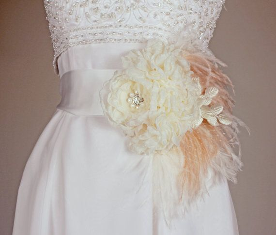 Chiffon, feathers and vintage touches topped with a rhinestone and pearl brooch $215.00